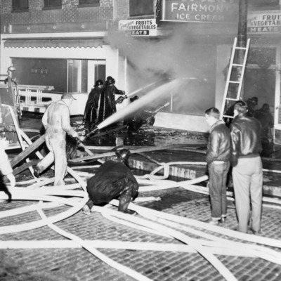 Fire Fighters - Wigwam Grocery, Cunningham Grocery, Hansen's Pastry Shop 100-104 W Broadway 11-4-1952.tif